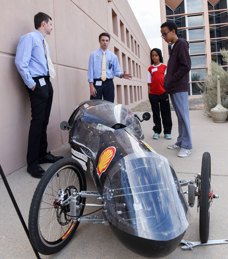 Students show visitors to NREL's Education Center their winning car.