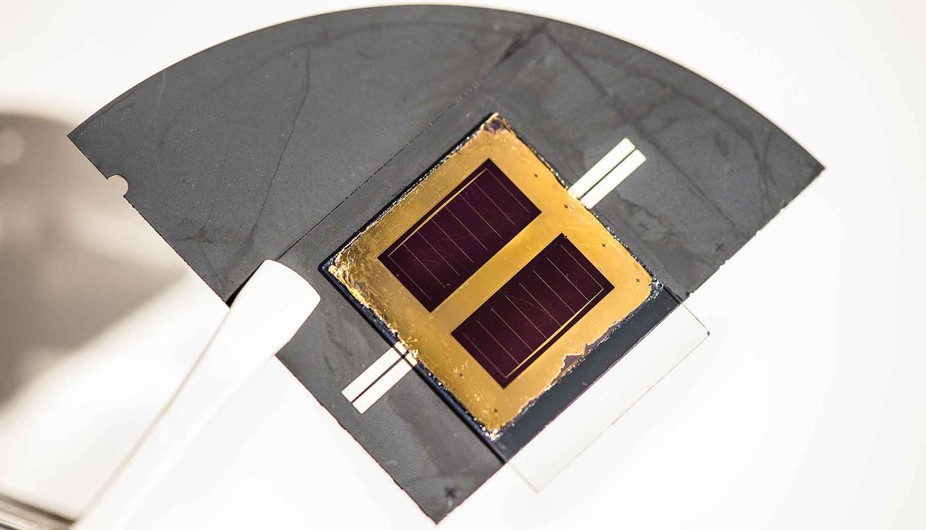 Photo shows a close-up view of a solar cell.