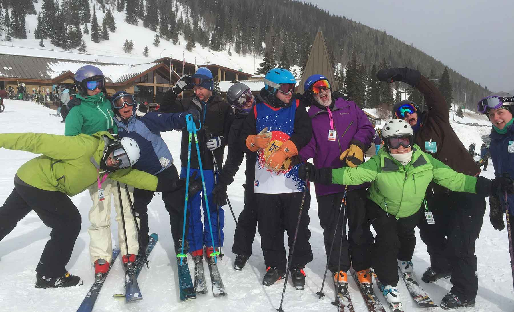 A group of skiers pose on a slope.