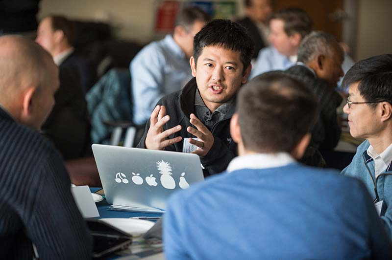 Photo of NREL researchers talking.