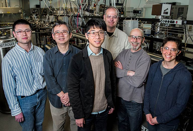 Six scientists involved with the newly published research into perovskites stand inside a laboratory.