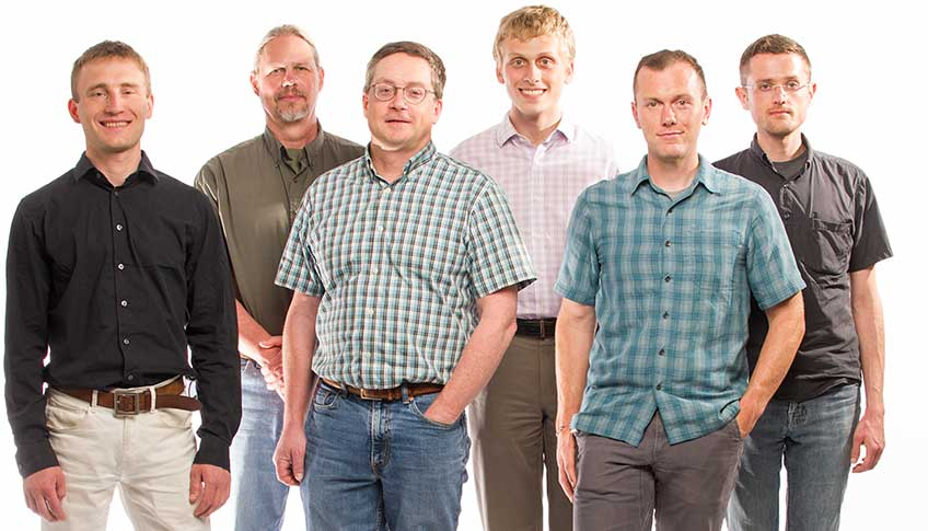 Six men with NREL's HTEM Database group pose for a photograph.