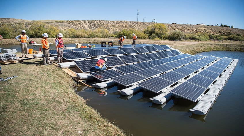 Photo shows solar panels floating on a body of water.