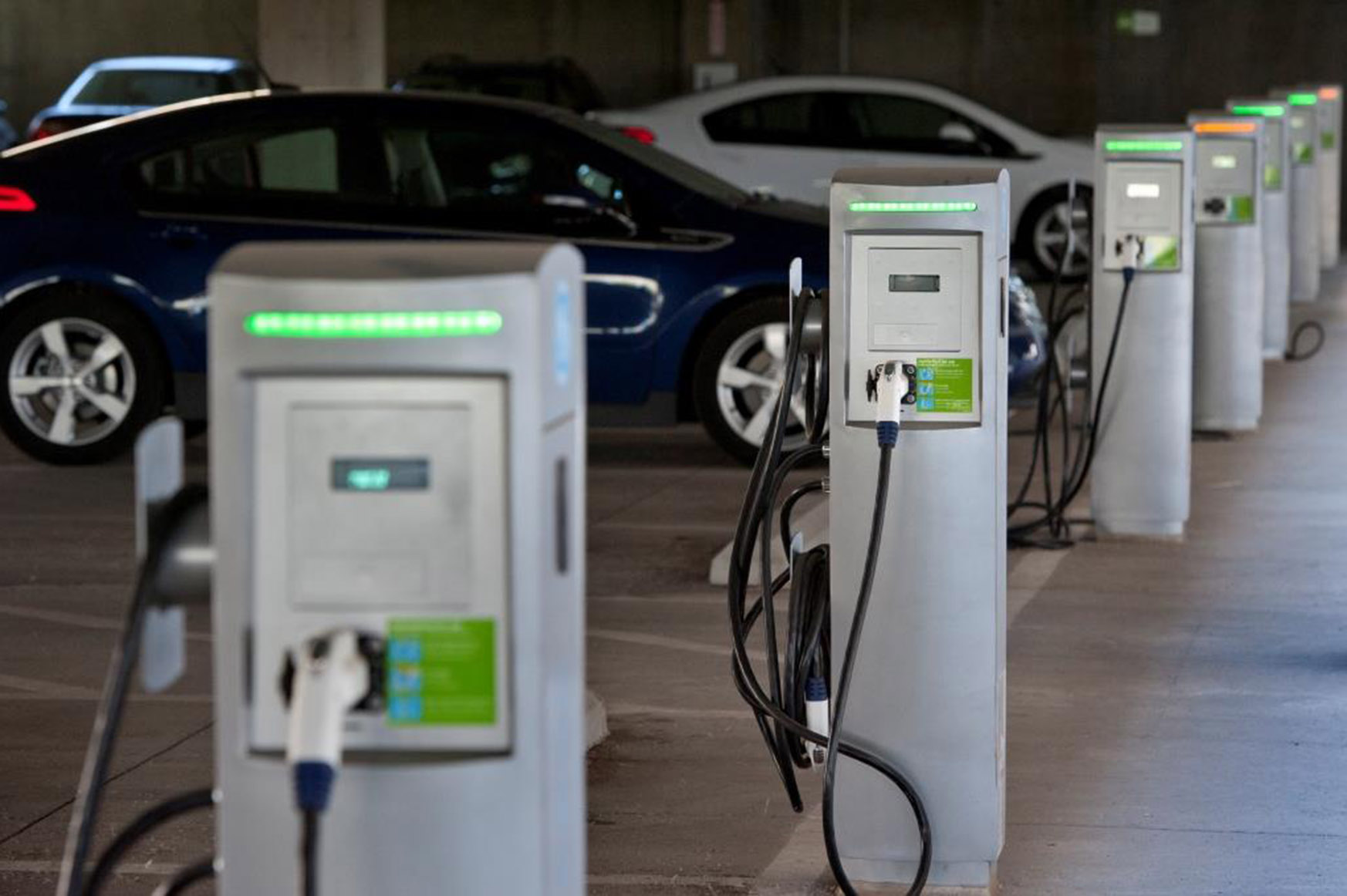 Photo of electric vehicle charging stations in parking garage.