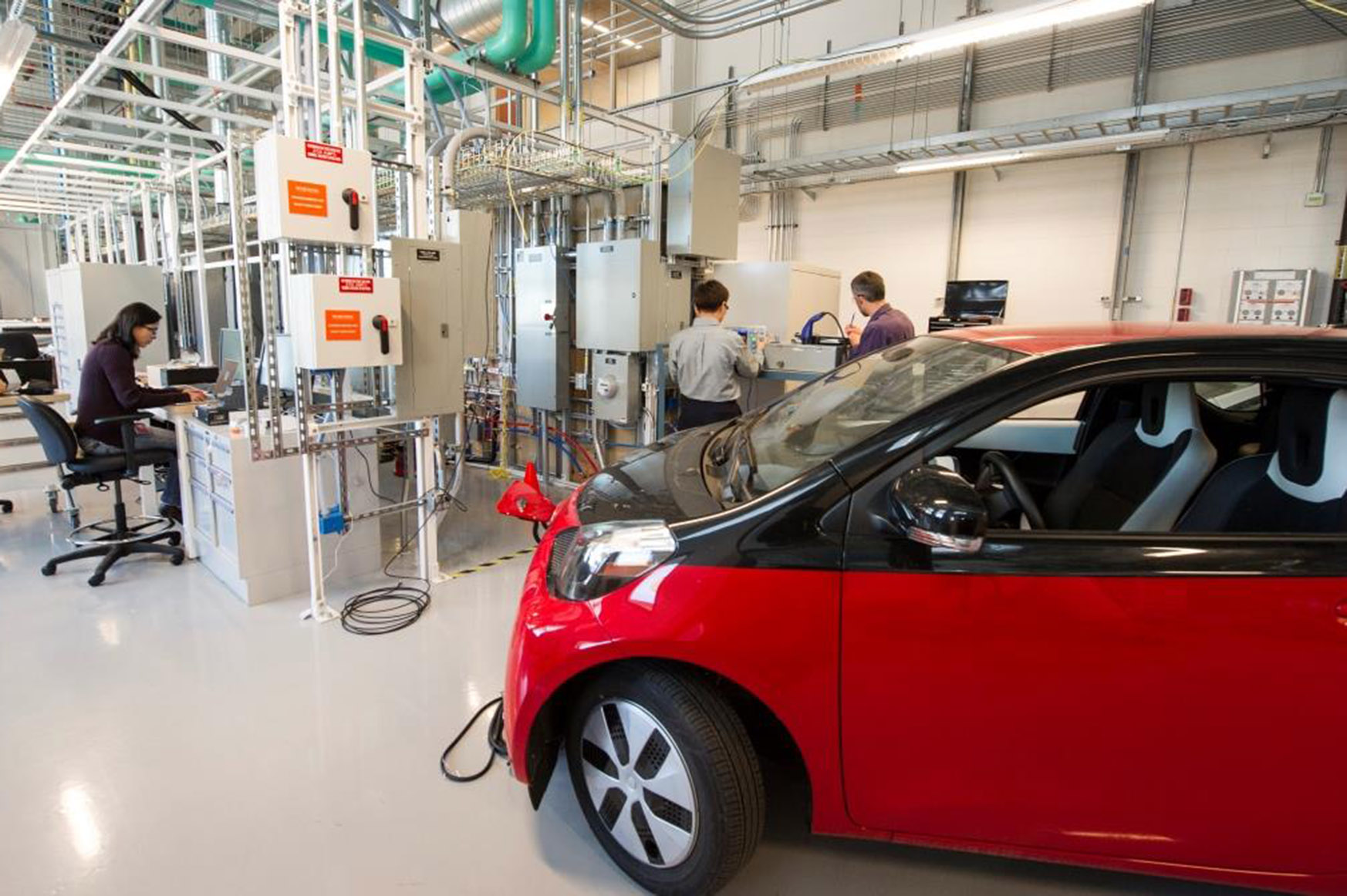 Photo of electric vehicle in laboratory setting.