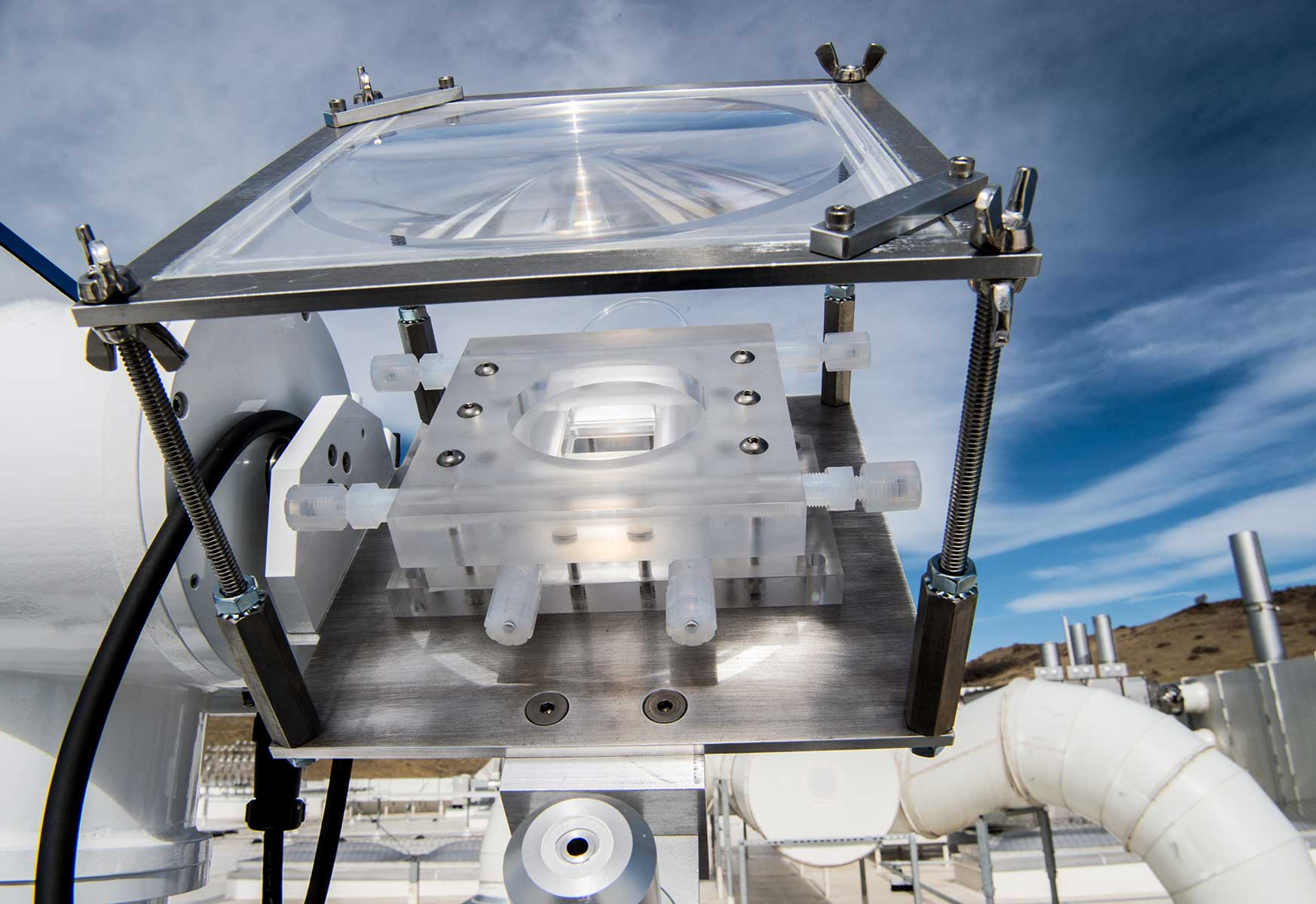A photoelectrochemical hydrogen production device mounted on a solar tracker on the roof of the Energy Systems Integration Facility.