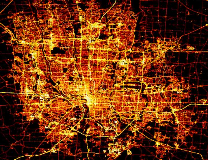 Heat map image depicting roadways with varying levels of use, with the roads traveled most frequently appearing brighter than the roads traveled less frequently.