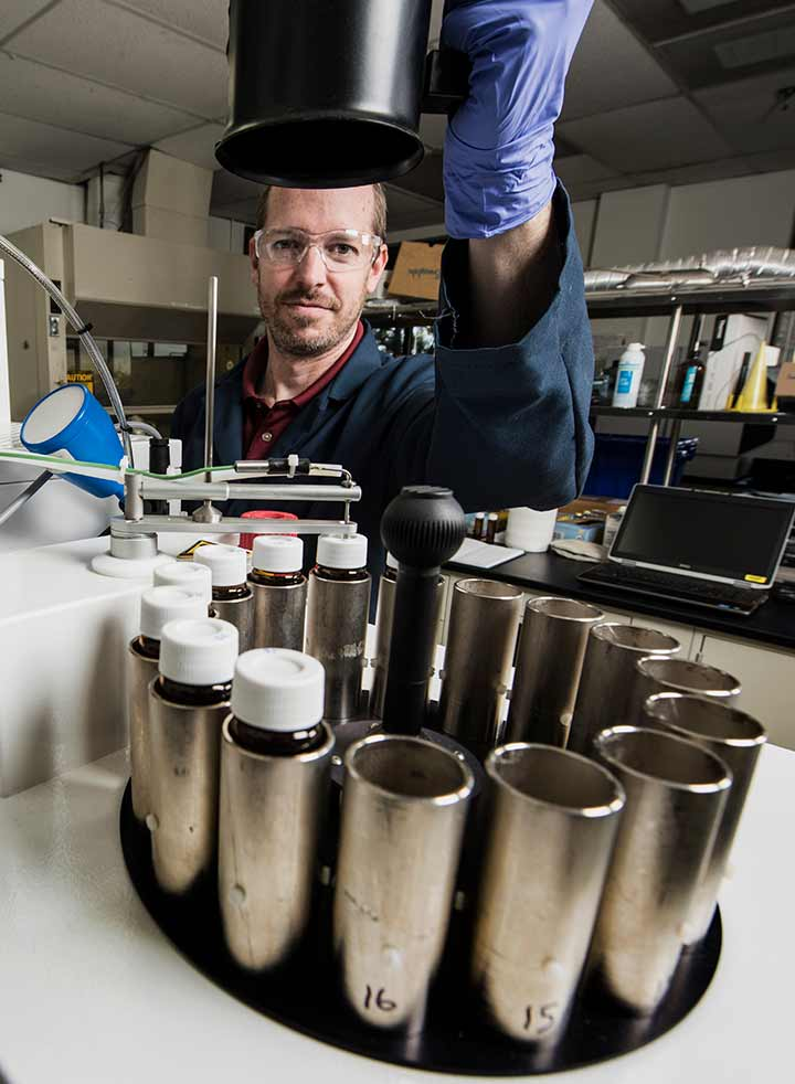 A researcher analyzes fuel samples in the National Renewable Energy Laboratory's Fuels Lab.
