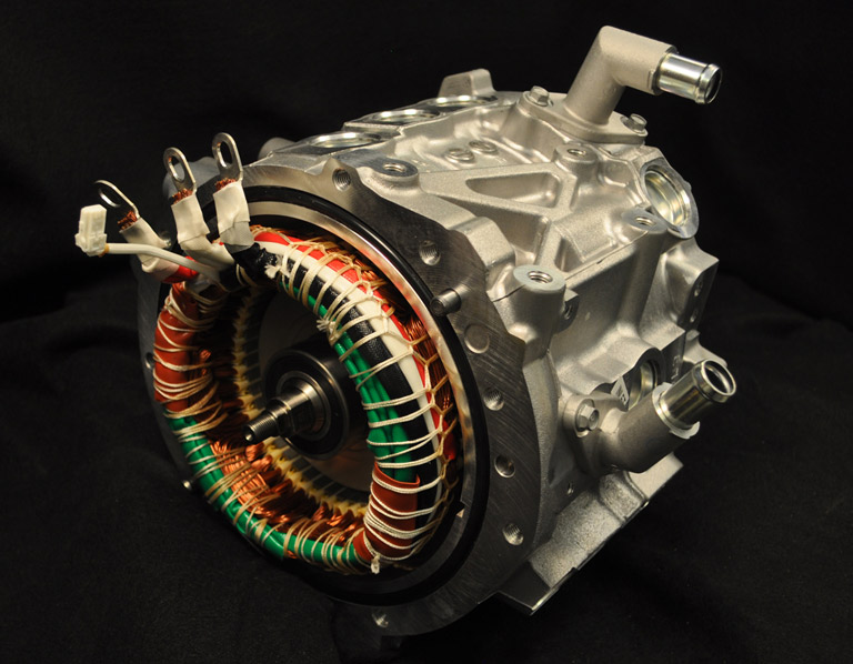 A silver electric motor with colored wires wrapped around the front