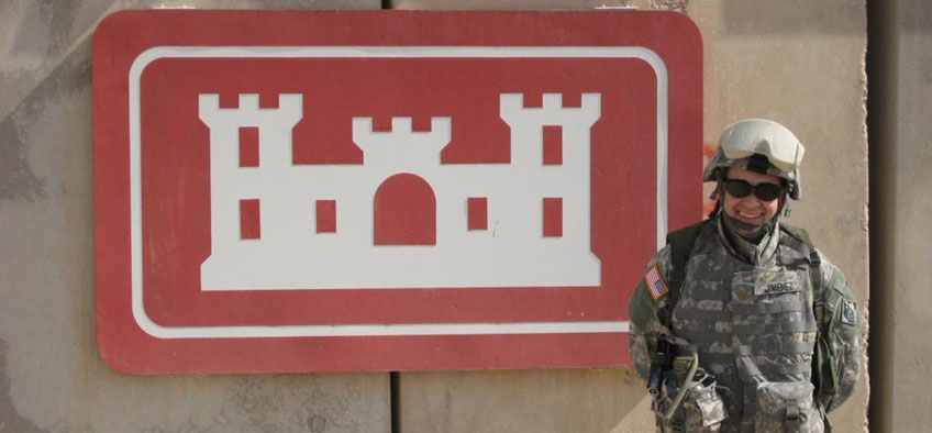Soldier stands in front of sign