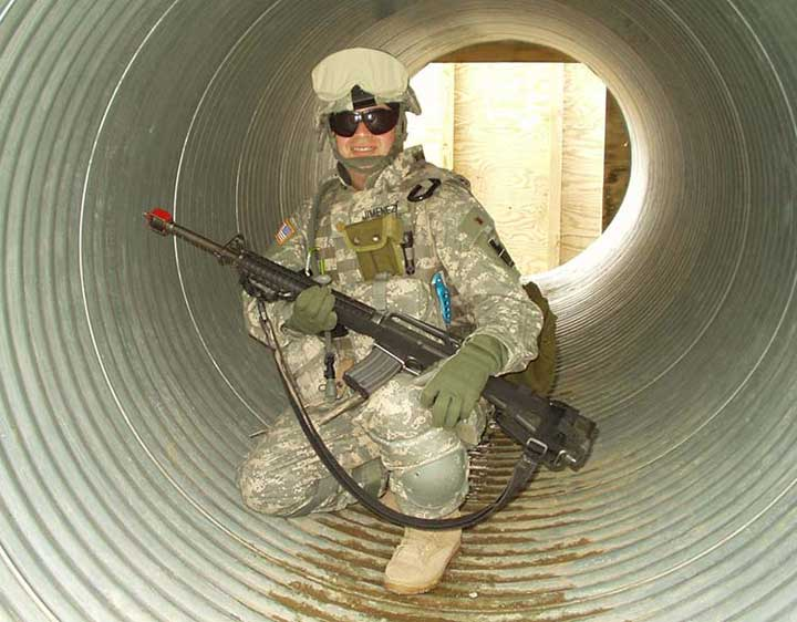 Soldier squats in tunnel