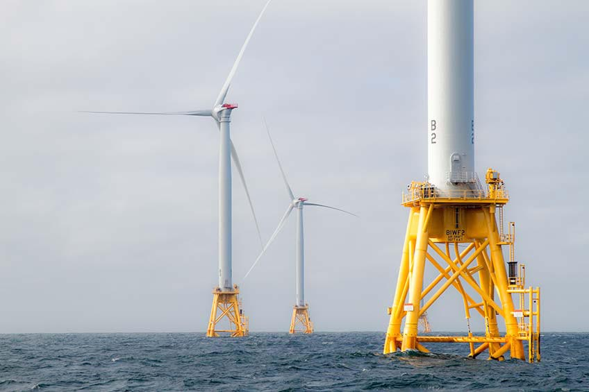 Three offshore wind turbines off the coast of Rhode Island.