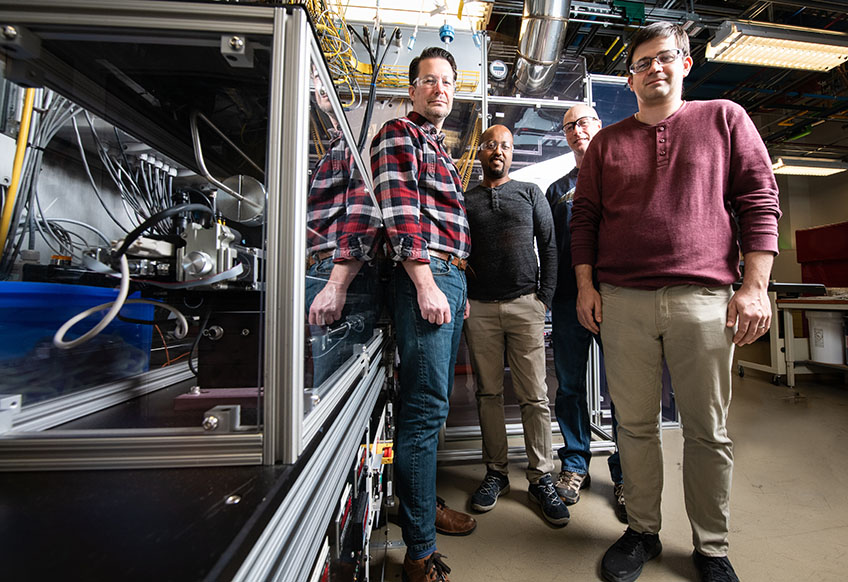Four researchers stand in the lab.