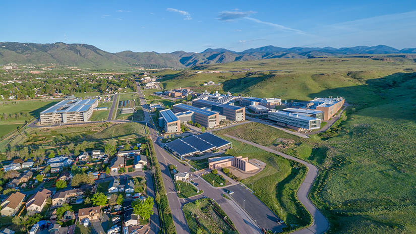 Aerial photo of NREL's South Table Mountain campus buildings and surrounding community