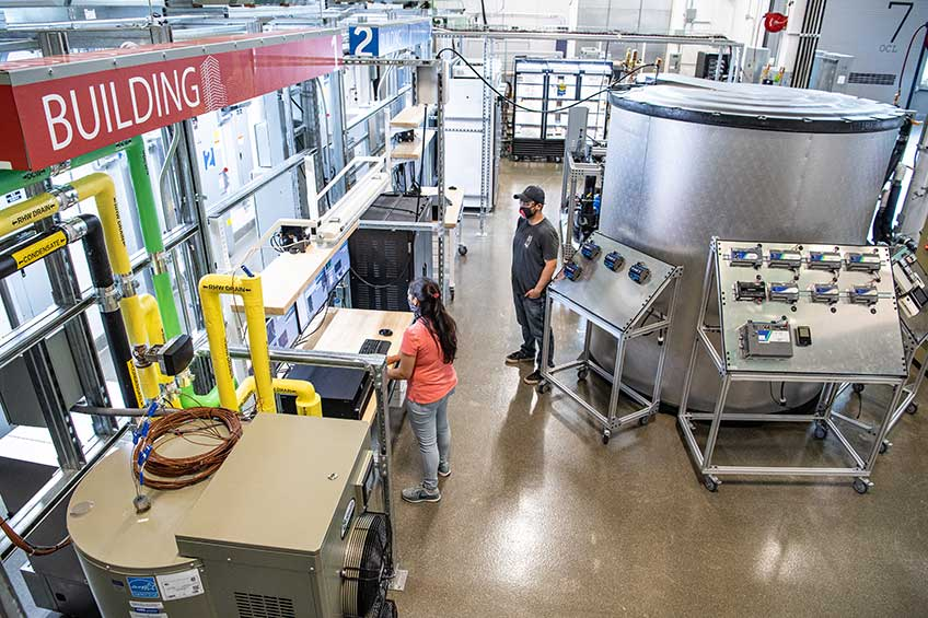 NREL researchers work in the Optical Characterization and Thermal Systems lab.