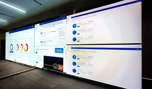 Photo of monitors showing the Distributed Energy Resources Cybersecurity Framework, one of the tools NREL cybersecurity researcher Charisa Powell helped develop to secure energy systems.