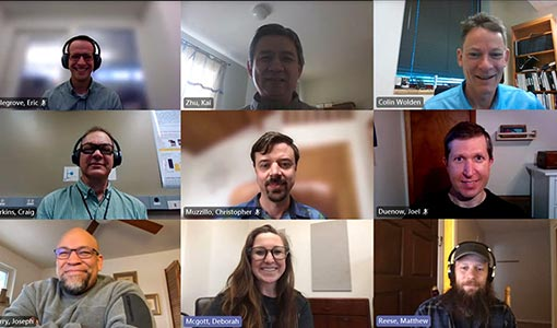 Photo of nine researchers in a 3X3 grid pattern, taken from a Microsoft Teams video call.