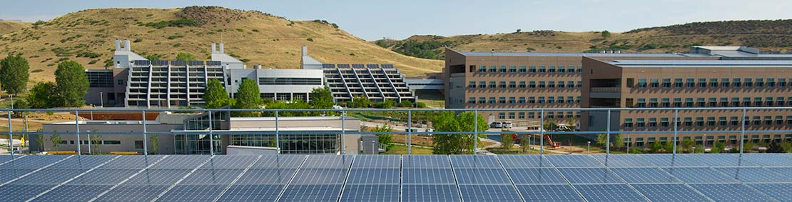 Solar panels line the rooftop of the parking garage at the south table mountain campus of NREL.