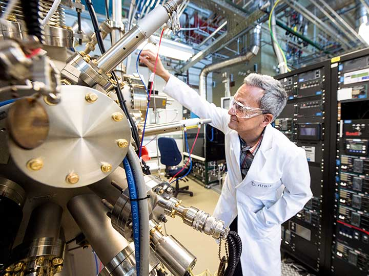 Photo of a scientist in NREL lab.