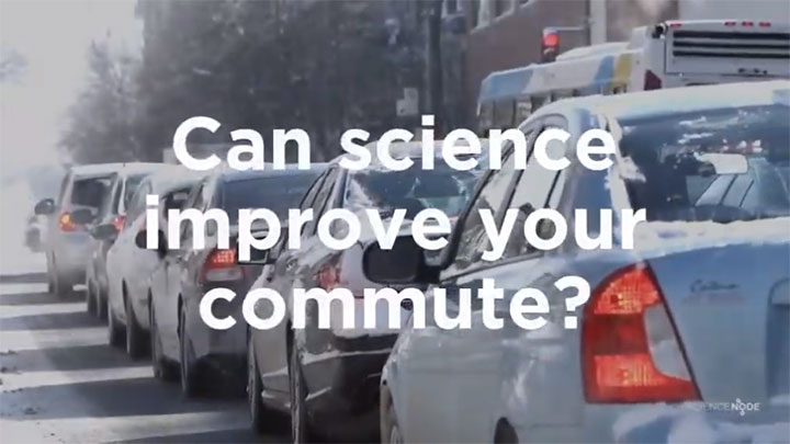 "Vehicles drive in a line of traffic with a text overlay that says ""Can science improve your commute?"""
