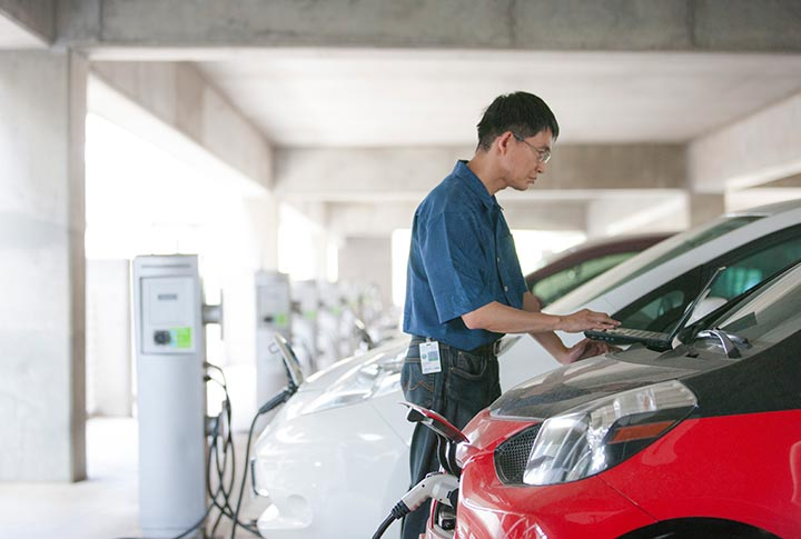 A researcher analyzes data for an electric vehicle plugged into Level 2 electric vehicle supply equipment