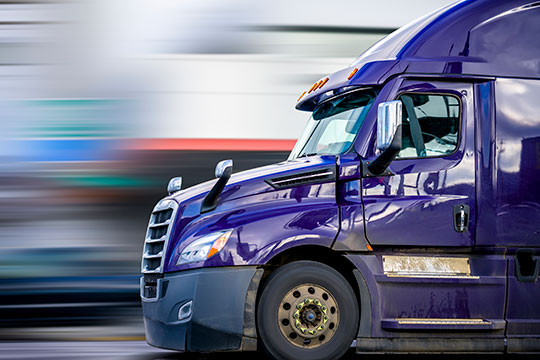 A purple semi-truck
