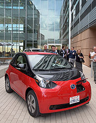 Photo of a red electric vehicle in front of ESIF