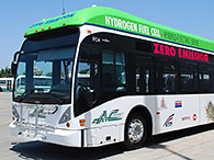 A photo of a public hydrogen fuel cell bus parked in a parking lot.
