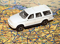 Photo of a model van on top of a U.S. map.