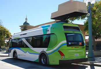 Photo of transit bus and overhead charging unit.