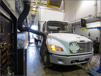 Photo of a heavy-duty truck being driven on a chassis dynamometer.