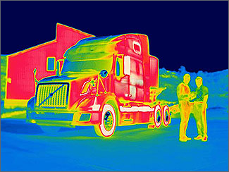 Infrared image of a semi cab and two people.