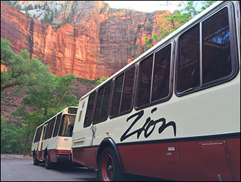 Photo of shuttle buses in mountain setting.