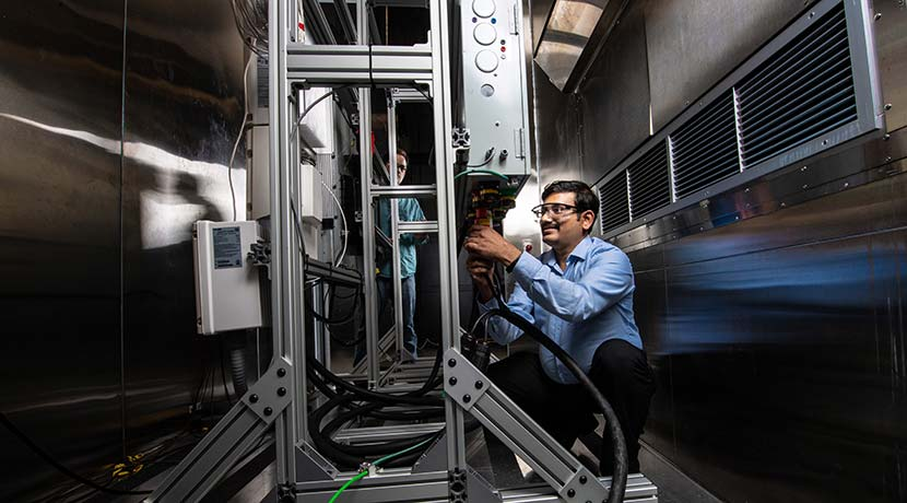 A researcher conducting energy storage research at NREL's Energy Systems Integration Facility.