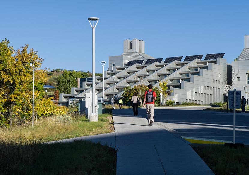 A photo of employees walking to NREL's Solar Energy Research Facility.