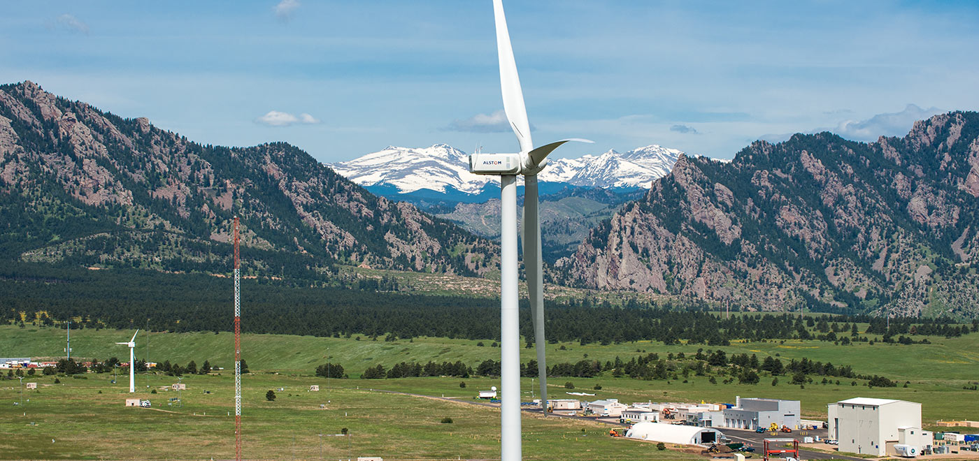 Photo of a wind turbine close-up with mountains in the background at NREL's National Wind Technology Center.